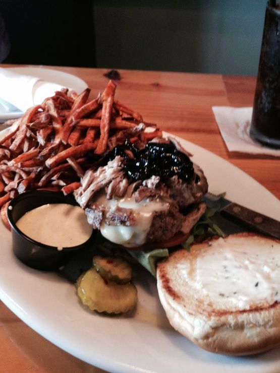 Duck confit-topped burger at WVO